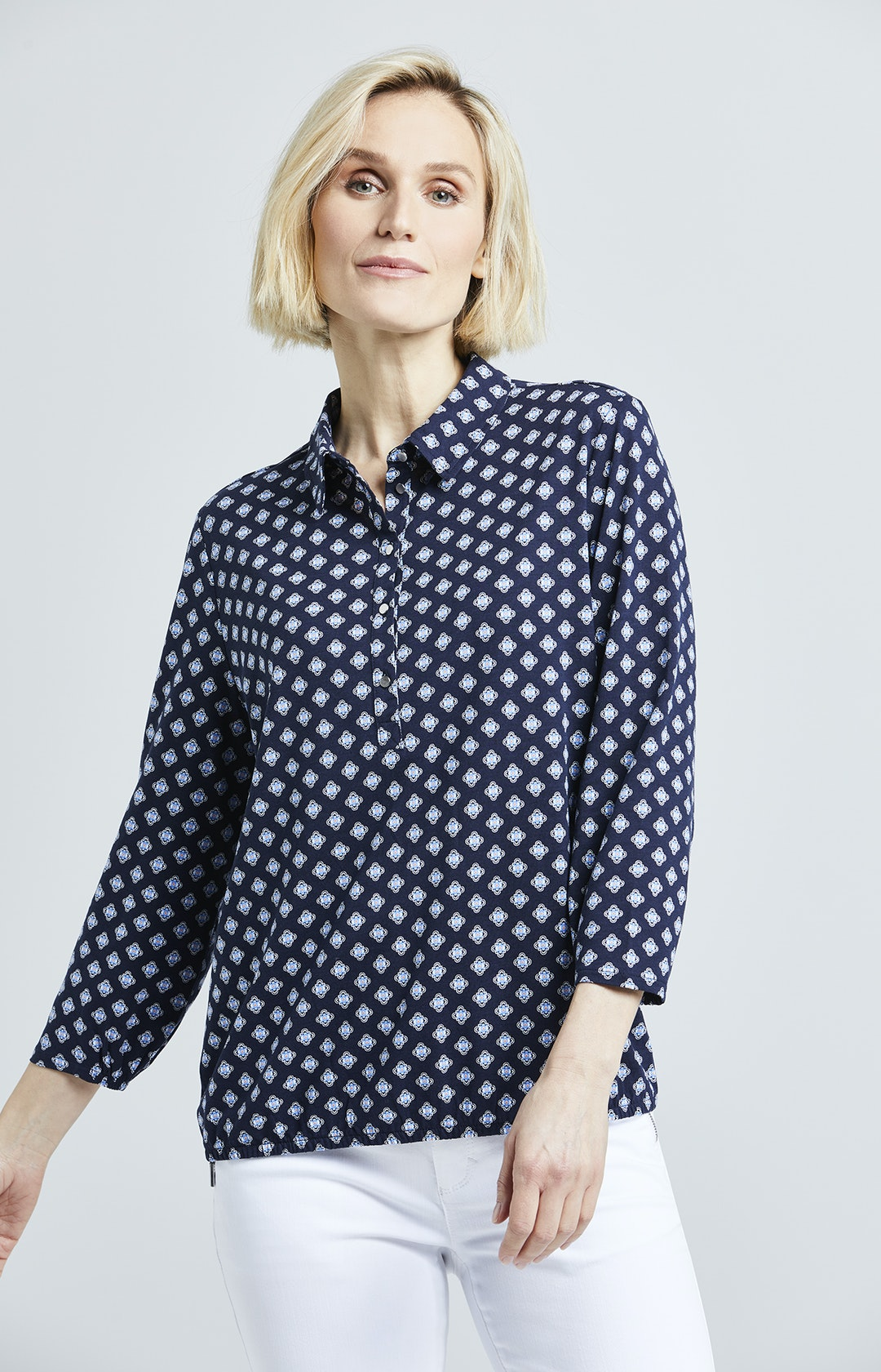 Poloshirt mit Allover-Muster in Blau
