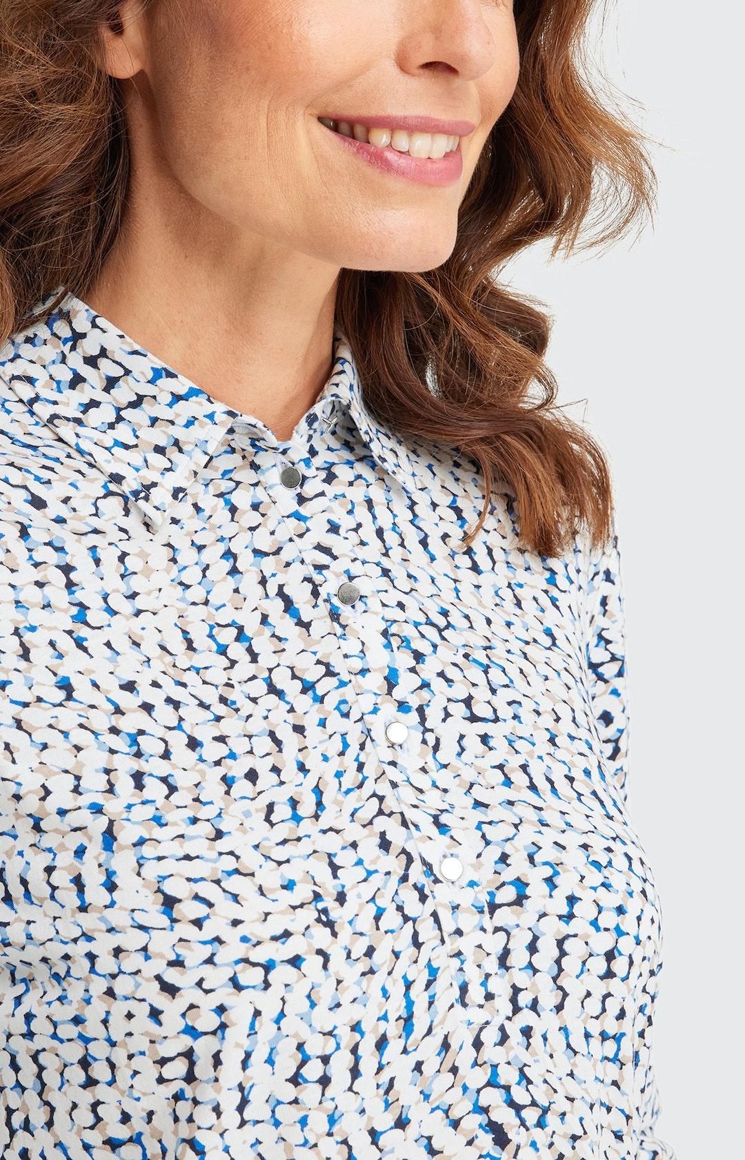 Poloshirt mit Allover-Muster in Weiß